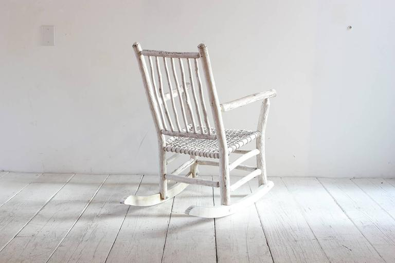 Wood painted rocking chair with rope seat.