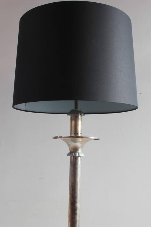 Italian nickel floor lamp with floral motif with a custom black book cloth lampshade.
