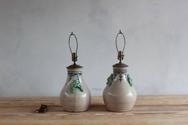 Pair of ceramic lamps with celadon glazed embellishments and blue details.