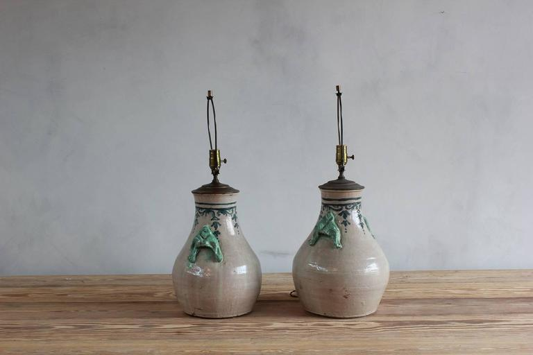 Mid-20th Century Pair of Ceramic Lamps with Celadon Glazed Embellishments and Blue Details For Sale