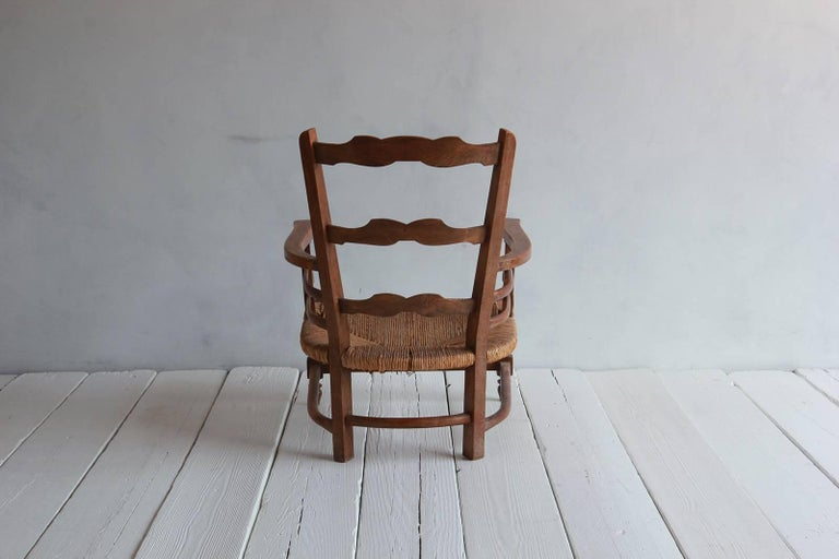 Pair of Low French Farmhouse Chairs with Woven Rush Seat In Distressed Condition For Sale In Los Angeles, CA