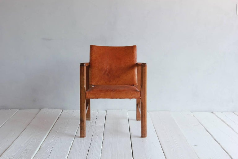 Pair of Borge Mogensen style leather and wood chairs.
