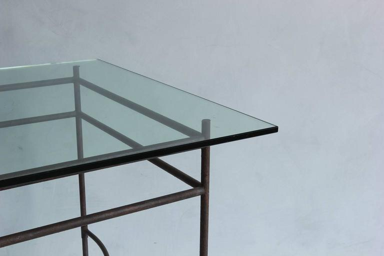Tall iron and glass table.