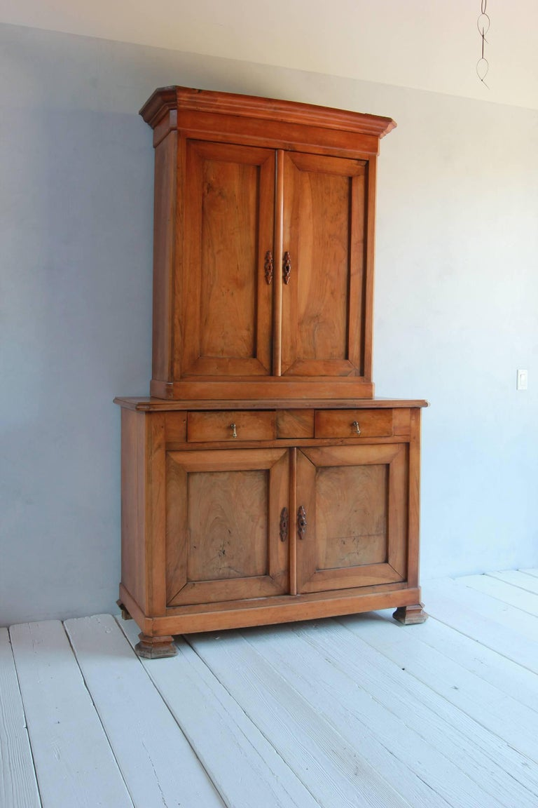 Large two-piece elmwood linen press hutch with fully lined interior.