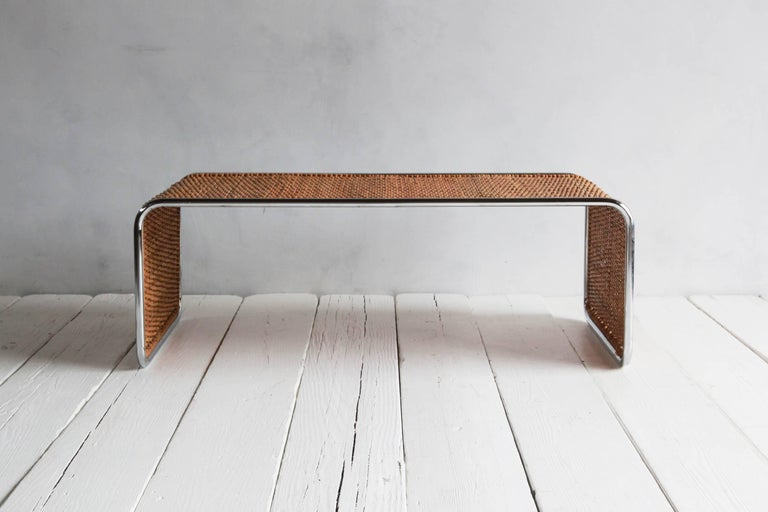 Waterfall style chrome and rattan coffee table.