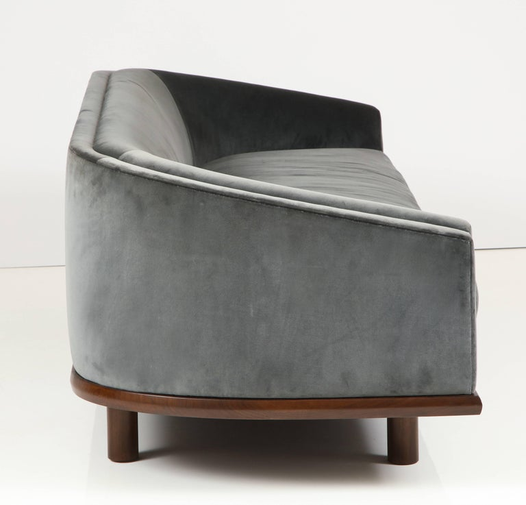 NK Curved Sofa Upholstered in Velvet with a Walnut Exposed Base In Excellent Condition For Sale In Los Angeles, CA
