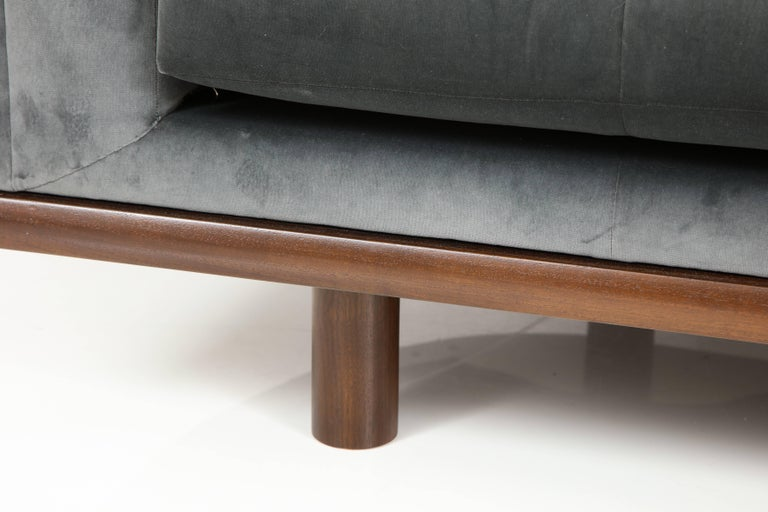 Contemporary NK Curved Sofa Upholstered in Velvet with a Walnut Exposed Base For Sale
