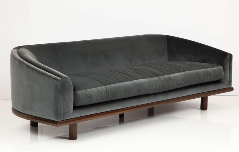 NK Curved Sofa Upholstered in Velvet with a Walnut Exposed Base For Sale 1