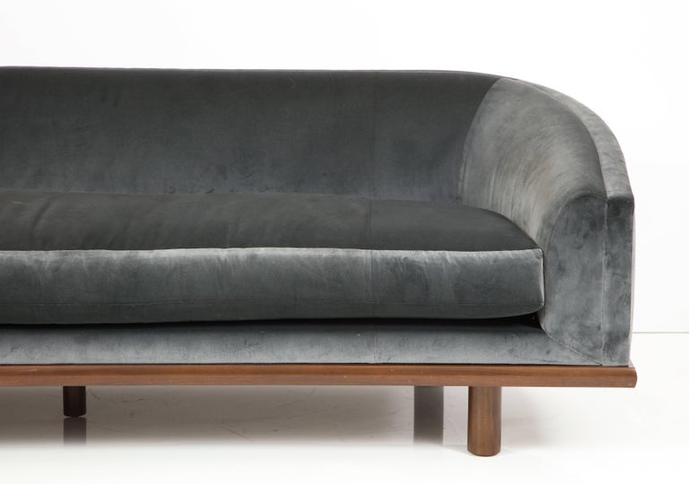 NK Curved Sofa Upholstered in Velvet with a Walnut Exposed Base For Sale 2