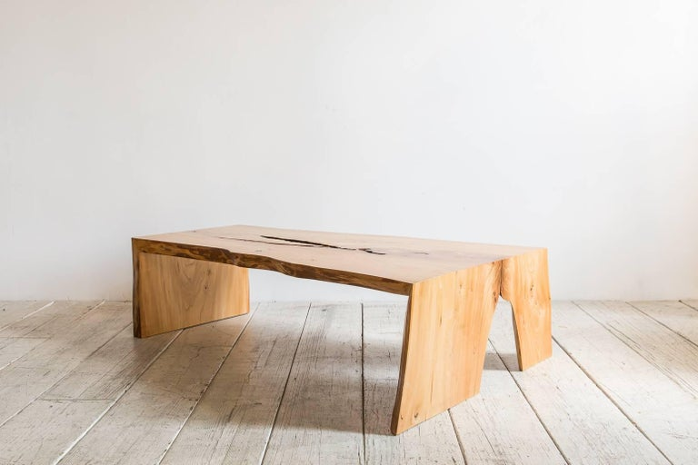 Live edge coffee table with waterfall legs.