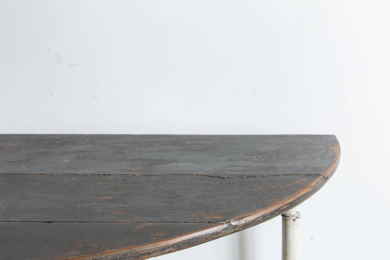 Late 19th Century Rustic Wooden Demilune Table with White Painted Base and Cylindrical Feet For Sale