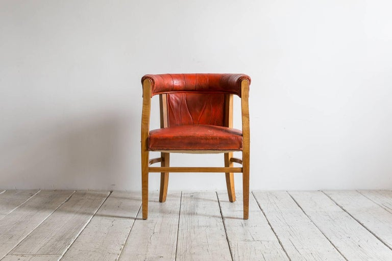 Captain pull up chairs upholstered in red distressed leather frame is made of maple wood.