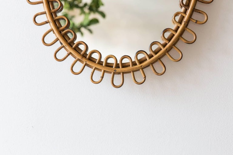 Curled oval wicker mirror from France.