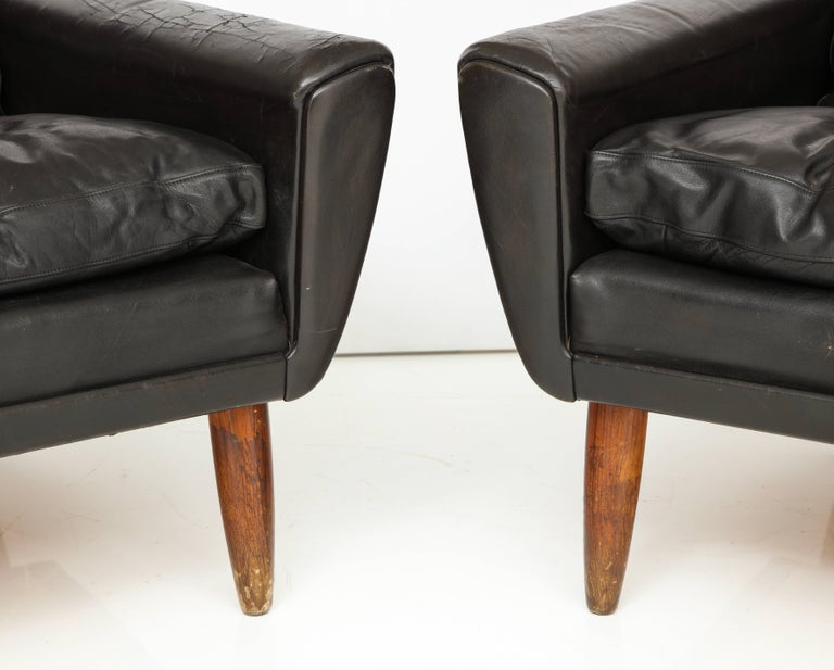 Pair of Midcentury Black Leather Chairs from France In Distressed Condition For Sale In Los Angeles, CA