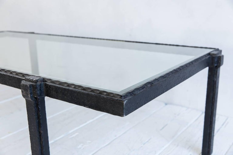 Rectangular Brutalist iron and glass cocktail table.