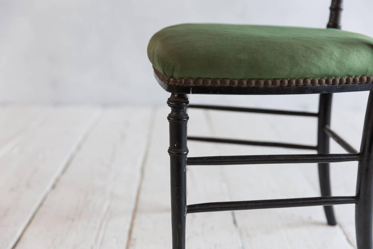 Early 20th Century French Chiavari Black Framed Chair Upholstered in Original Green Fabric For Sale