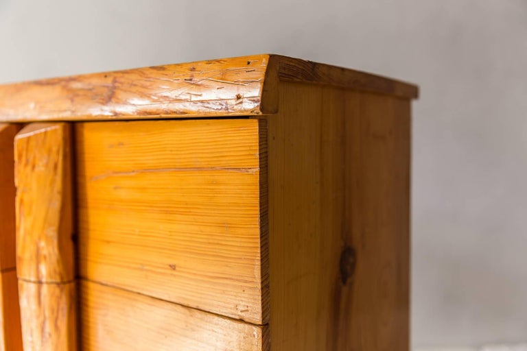 Rustic four-dresser with live edge handles.