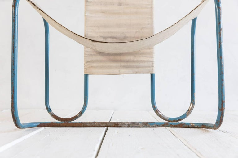 Painted blue metal Bauhaus sling chair with original canvas upholstery.