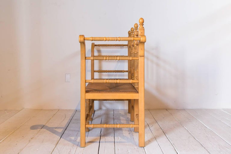 Edwardian Style Light Oak Spindle Bench with Rush Seat and Curved Arms In Distressed Condition For Sale In Los Angeles, CA