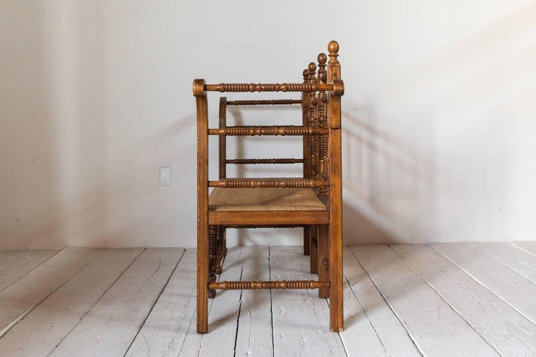 Dark Oak Edwardian Spindle Bench with Rush Seat In Distressed Condition For Sale In Los Angeles, CA