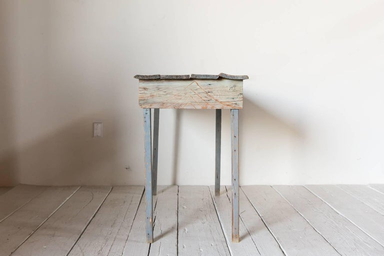 Primitive blue painted South Western style console table with geometric carved details.