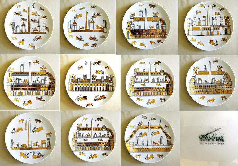"Vintage Piero Fornasetti set of nine porcelain plates, Anfiteatro (Amphitheatre), 1960s.  Each plate is decorated distinctively with different scenes of ""Ancient Rome"" in black and with exotic buildings, chariots, lions and"
