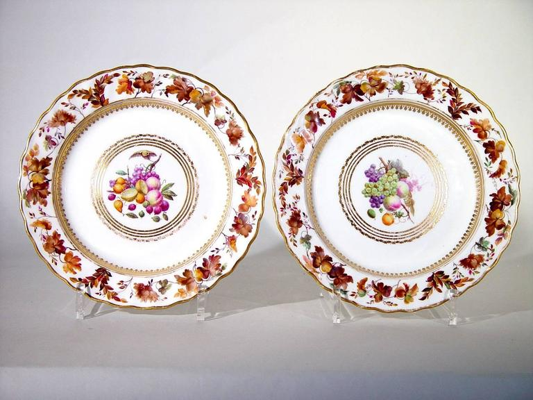 The Derby porcelain plates are painted by William Longden with fruit within a heart-shaped gilt border. The fruit depicted include grapes, plums, strawberries, raspberries and apples amongst others. The rim in yellow highlighted with gold with a