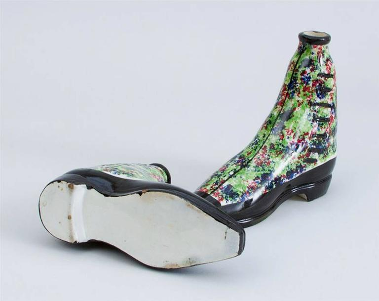 British pottery parlware sponged spirit flasks modeled in form of boots, 