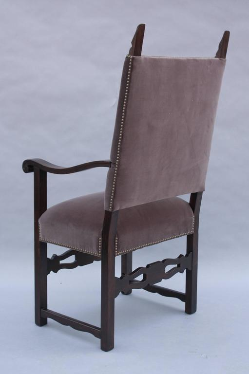 Carved Spanish revival armchair with new velvet upholstery, circa 1920s.
