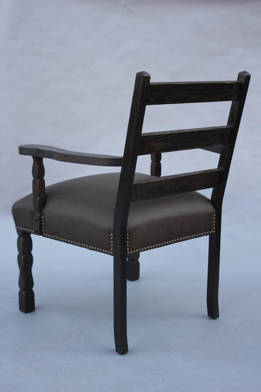 Armchair with dark finish and new riveted upholstery, circa 1920s.