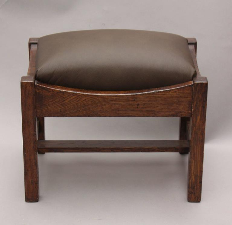 Craftsman period foot stool with new leather upholstery.