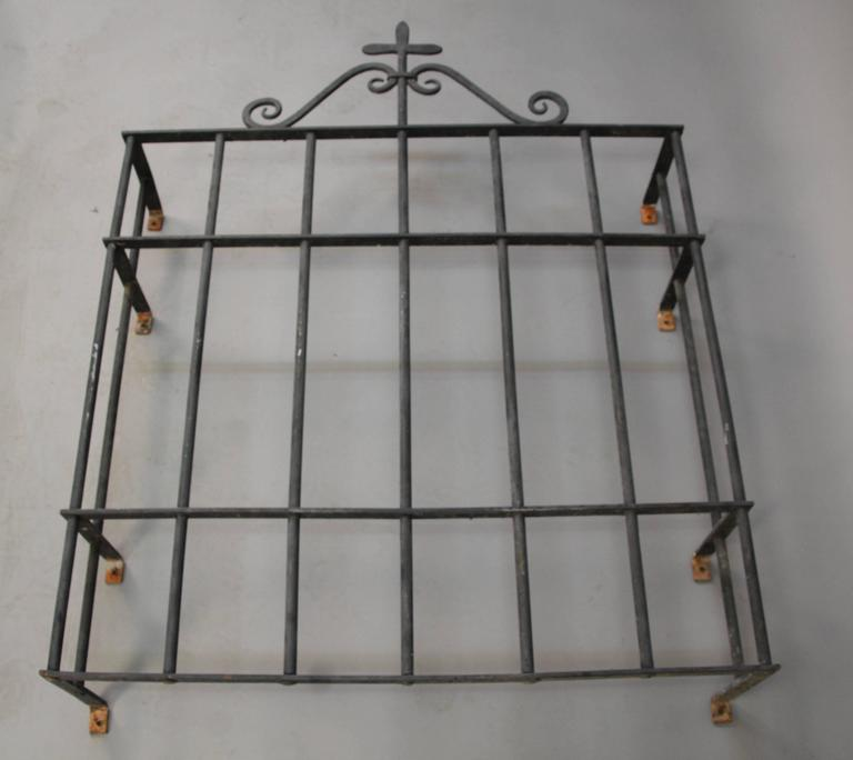 Beautiful and finely crafted 1920s wrought iron window grill. We have a matching, larger piece available. 