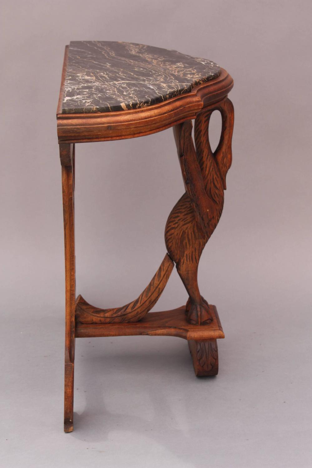 Antique hand carved marble top table with swan motif for