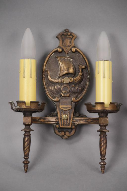 Sconces with ship motif, circa 1920s.