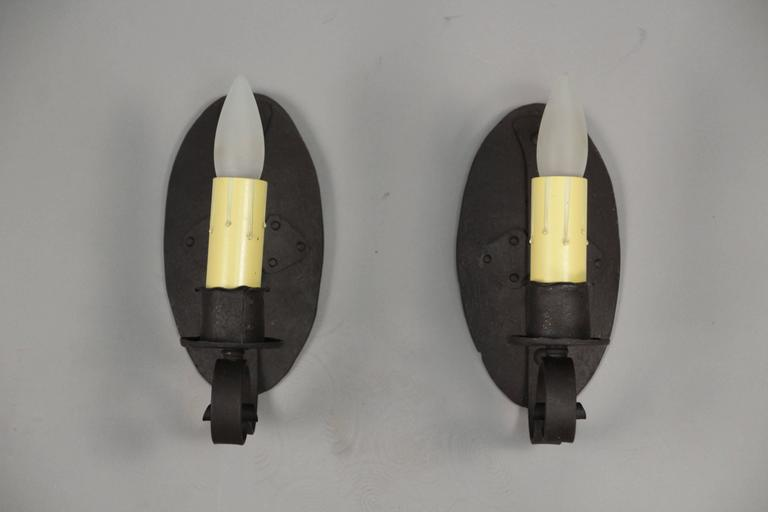 Wrought iron sconces with nice simple and strong design, circa 1920s.
