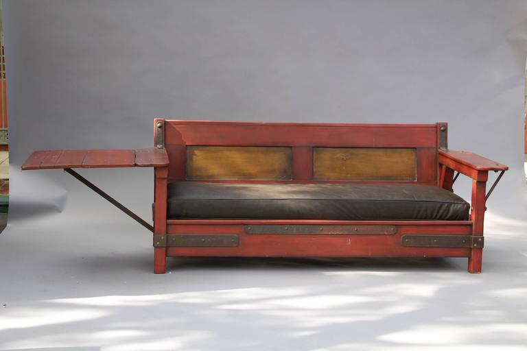 Circa 1930's Monterey red couch with one drop arm. Signed. Finish was restored years ago. 
