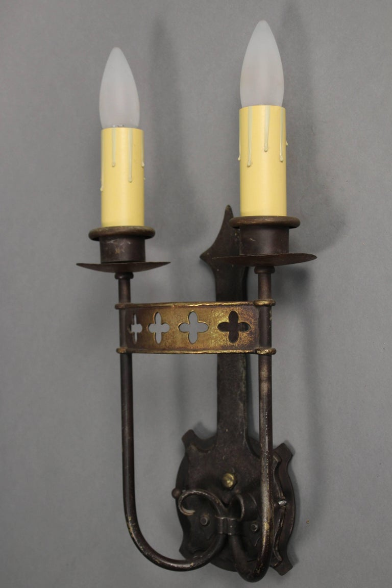 Sold and priced individually. Double sconce with original finish, circa 1920s.
