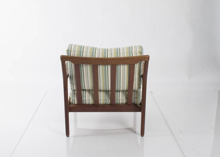 Pair of Mid-Century lounge chairs upholstered in striped fabric.