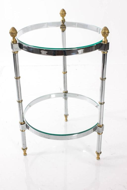 Mid-Century two-tiered brass and chrome cocktail table with finial details.