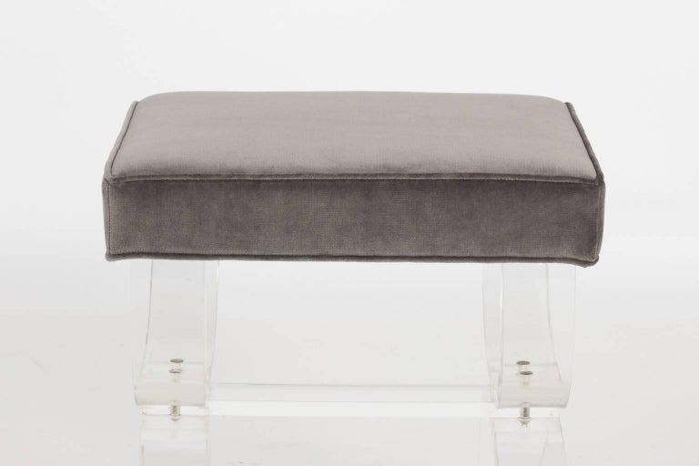Pair of Hill Manufacturing Lucite stools that are newly upholstered in grey velvet with curule shaped legs, circa 1970.