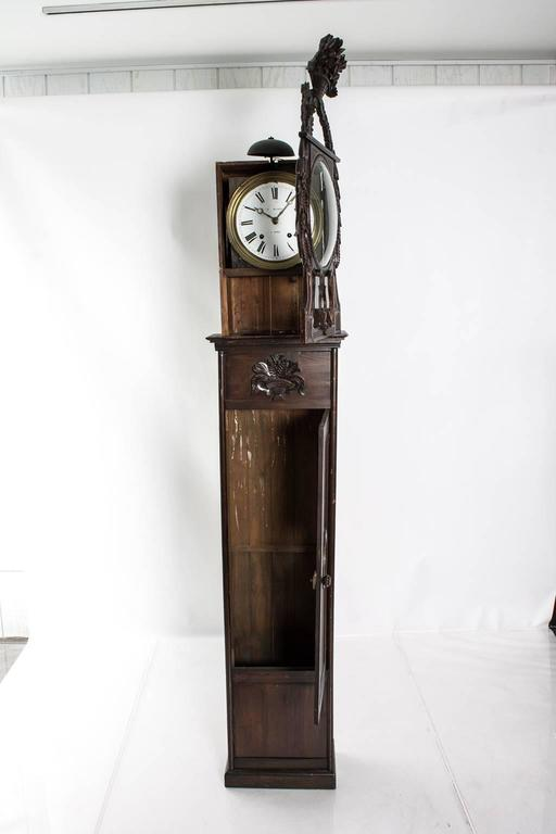 19th century French pine grandfather clock with carved flowers, wheat and basket of fruit. Clock face signed: Auffay, Mesaize.