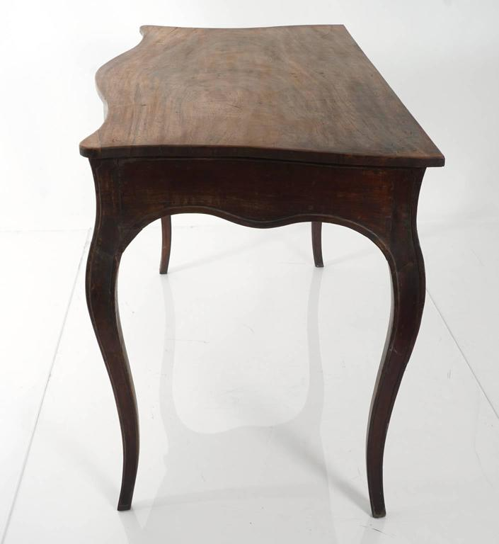 Early 20th century mahogany table with scalloped apron. The table is unfinished.