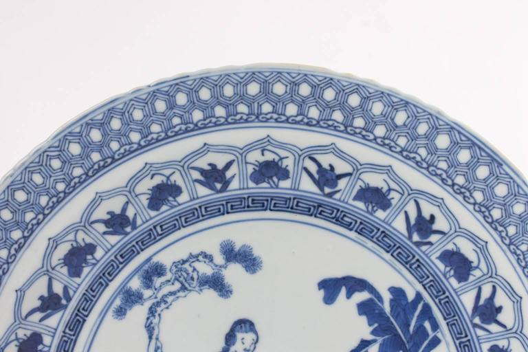 Antique Chinese blue and white plate depicting a garden scene.