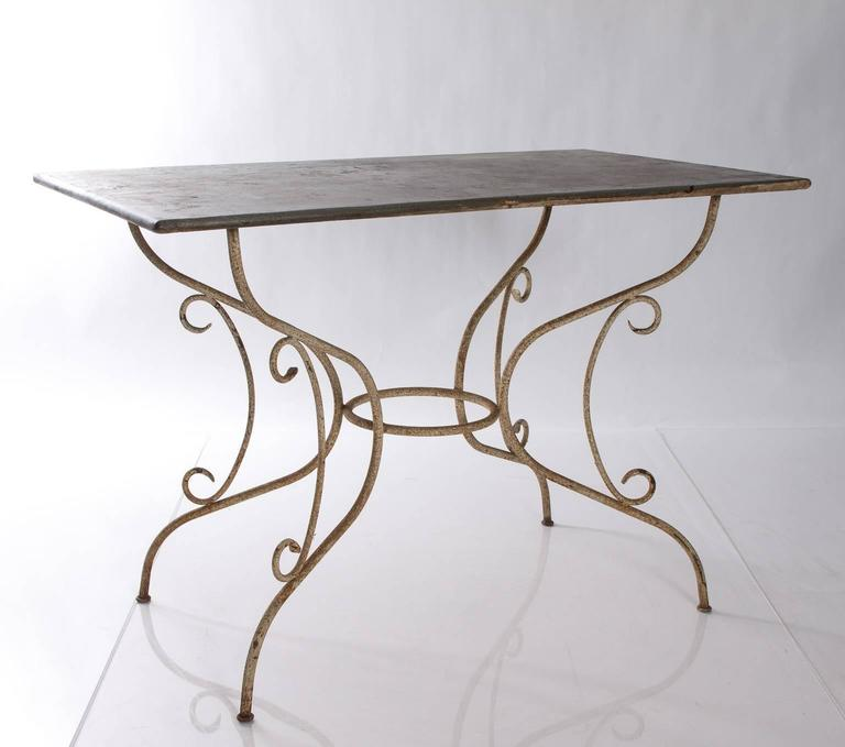 1960s iron and steel garden table, with patinated finish.
