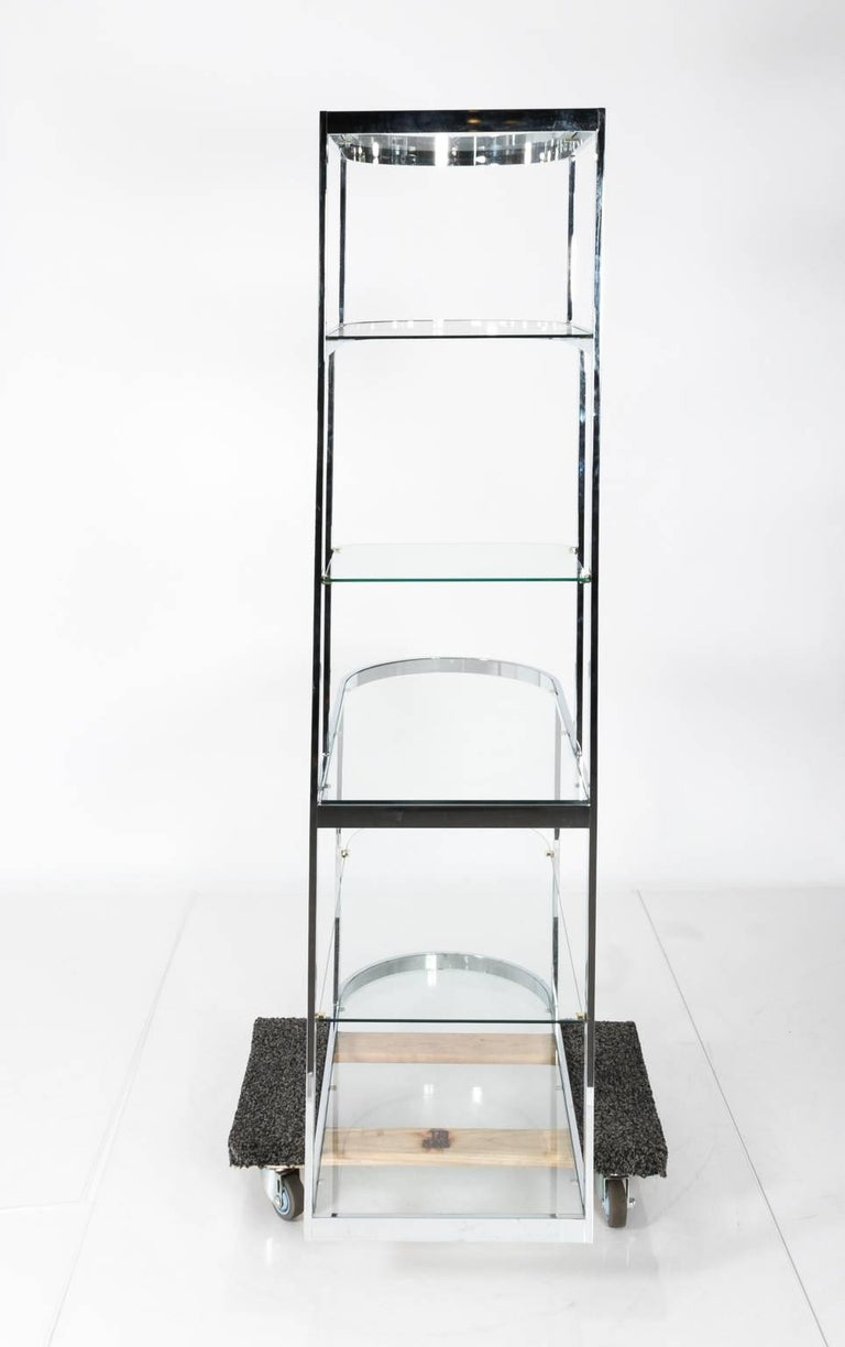 Chrome and glass étagère with rounded sides, circa 1960s.