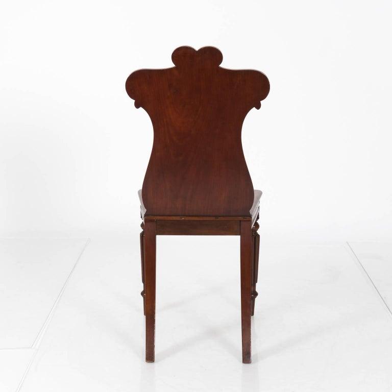 Pair of English Mahogany hall chairs, circa 1890.