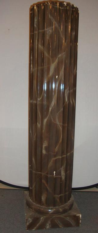 Pair of column style pedestals. The pair of pedestals come in a column style with a brown, marble like appearance.