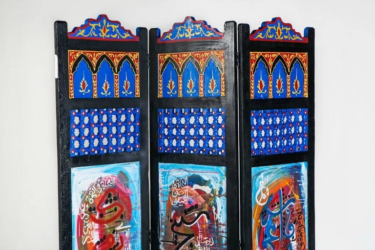 This hand-painted oasis decorative divider is the perfect way to create privacy and divide space. With vibrant colors, swirling abstract patterns and a Moorish design component, this decorative divider is a memorable addition to any living space in