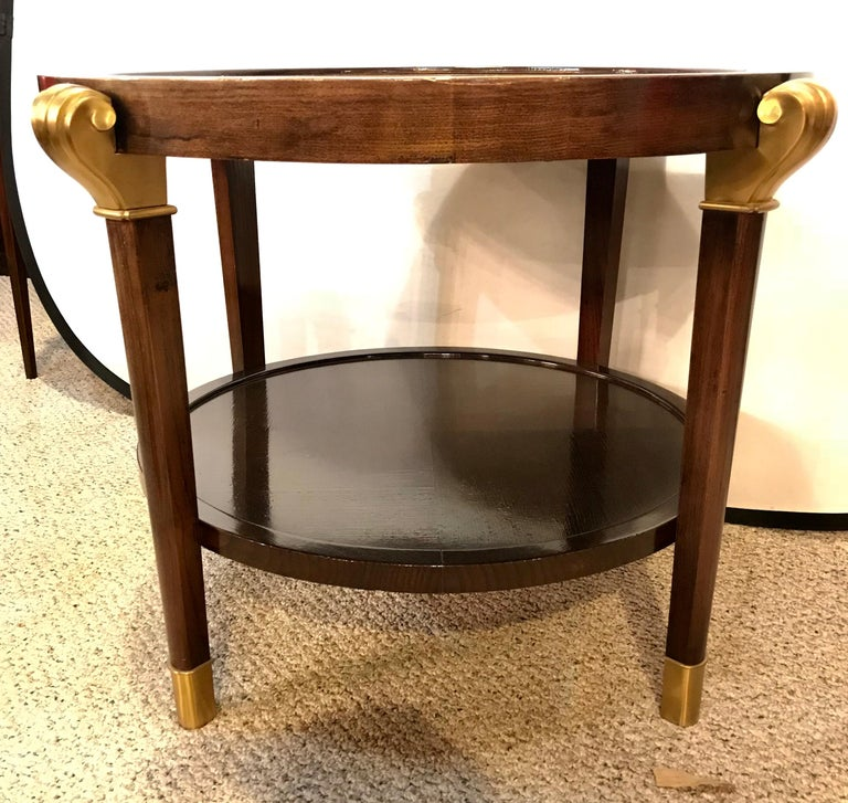 A mahogany reverse painted glass top centre, end or coffee table. Art Nouveau in form this fine custom quality centre table has bronze feet and terminate in bronze capitals. The top glass having a abstract floral reverse painted design on a gilt