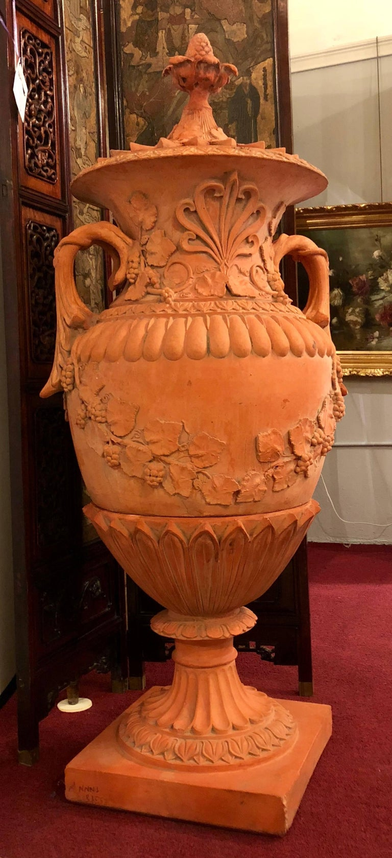 Pair of monumental late 19th-early 20th century. Terracotta three-piece lidded urns. These stunning garden urns can be used inside or outside the home in a garden. No matter where they stand they are certain to bring elegance and spark conversation.
